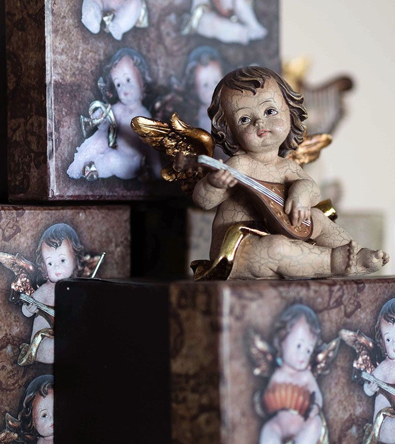 Angel holding instrument, classical style 4 options Height 8cm.